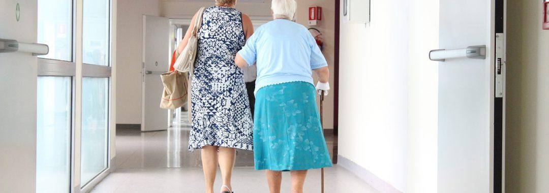 Women walking down a hospital corridor